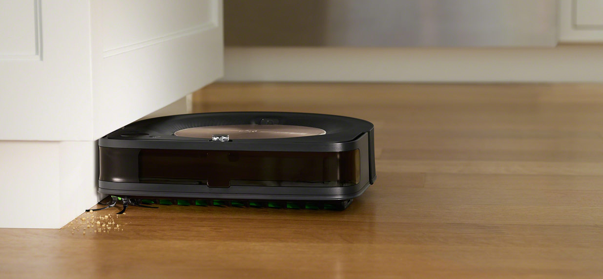 iRobot's Roomba s9 cleaning against the cabinet