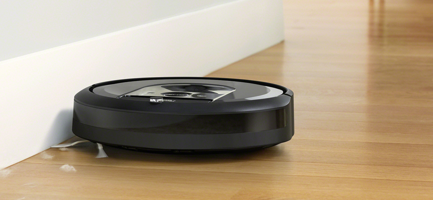 iRobot's Roomba i7 cleaning against the cabinet